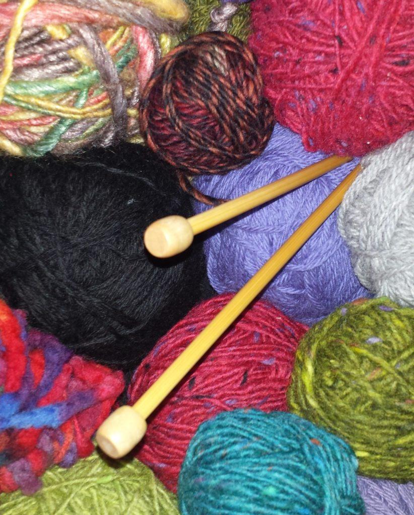 Yarns and knitting needles.